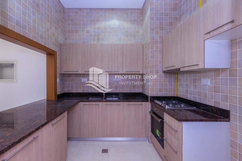 Kitchen-Island view Apt with balcony in Ansam.