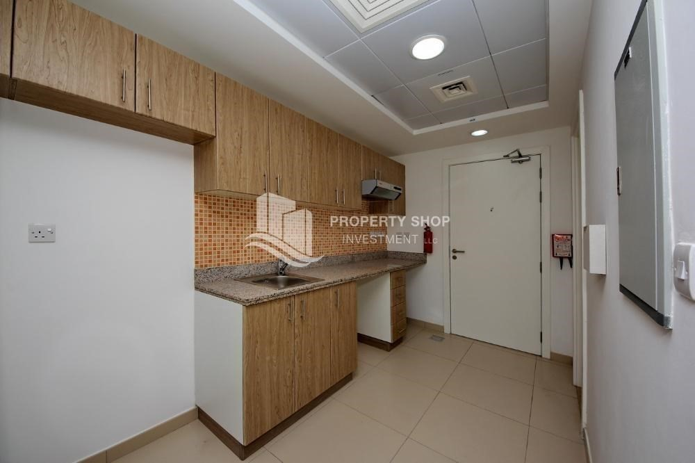 Kitchen-Amazing value for Studio Apt with Terrace for sale.